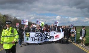 hundreds of anti-drone protesters march against uk flight-control centre